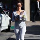 Kourtney Kardashian making a Starbucks coffee run in Calabasas, California on December 14, 2013
