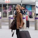 Caroline Flack flees the UK - 454 x 610