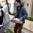 Trace and Noah bring their grandmother Christmas Dinner in Los Angeles, California on December 25, 2012 - 412 x 594