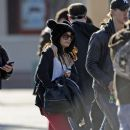 Vanessa Hudgens and Austin Butler were spotted walking through Disneyland, December 22, in California