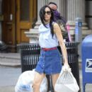 Famke Janssen – Leggy wearing a blue denim mini skirt in Soho