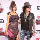 Nikki Sixx and Courtney Sixx attend the iHeartRadio Music Awards at The Forum on April 3, 2016 in Inglewood, California. - 400 x 600