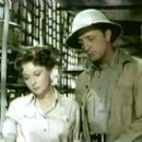 Susan Hayward and Robert Mitchum