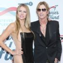 Duff McKagan and Susan attend the Steven Tyler's Grammy Awards Viewing Party Benefiting Janie's Fund on February 10, 2019 in Los Angeles, CA - 454 x 582