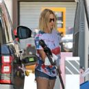 Ashley Benson – Looks cute in denim shorts at a gas station in Los Angeles