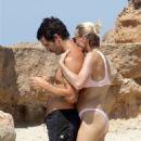 Robin Wright in Bikini at the beach in Formentera - 454 x 681