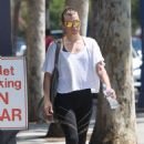 Milla Jovovich – Leaves the gym in West Hollywood
