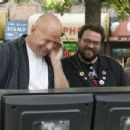 (L-r) BRUCE WILLIS and Director KEVIN SMITH on the set of Warner Bros. Pictures' crime comedy 'Cop Out.' Photo by Abbot Genser