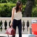 Miranda Kerr carefully walked over laid out boxes in Los Angeles, California on February 29, 2012