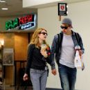 Chord Overstreet and his girlfriend Emma Roberts make their way through the terminal at LAX Airport on Thursday (July 28) in Los Angeles