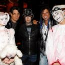 "(2nd L-R) Illusionist Criss Angel, guitarist DJ Ashba of Guns N' Roses and artist Michael Godard appear with ""Zarkana by Cirque du Soleil"" characters at the reception for the Las Vegas premiere of ""Zarkana by Cirque du Soleil"" at the Gold Boutique Nightcl"