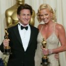 The 76th Annual Academy Awards: Sean Penn and Charlize Theron pose with their Oscar statuettes in 2004 - Press Room