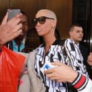 Amber Rose and Tara Reid were spotted posing for fans as they stepped out of their hotel in New York, New York - April 6, 2012