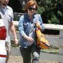 Couple Alyson Hannigan and Alexis Denisof spend some time together at a park in Brentwood, California on July 17, 2015 - 404 x 600