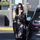 Olivia Munn – Spotted pumping gas in Los Angeles - 454 x 638