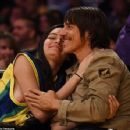 That's one Red Hot smooch! Anthony Kiedis, 52, shares passionate courtside kiss with Brazilian model Wanessa Milhomem, 22, at the LA Lakers game - 454 x 354