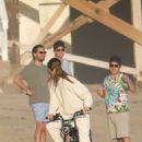 Sofia Richie – Riding motorbike on the beach in Malibu