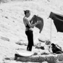 Robin Wright – Surfing at a beach in Malibu