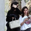 Kylie Jenner hides her face while being spotted out shopping at Fred Segal in West Hollywood, California on November 28, 2016