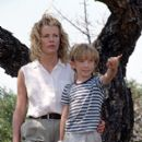 Having promised him to do something good and make a new start, Kuki (Kim Basinger) toils to make Kenya feel like home to her young son, Emanuele (Liam Aiken), in Columbia's I Dreamed Of Africa - 2000 - 267 x 400