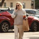 Emma Roberts in all beige as she grabs coffee in Los Angeles