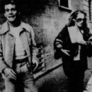 Ryan O'Neal and Ursula Andress - 409 x 454