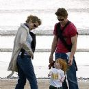 Julia, Danny and son Phinnaeus enjoy a day at the beach. - 300 x 400