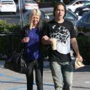 Tara Reid and her new boyfriend out shopping and getting a coffee at Starbucks in Los Angeles, California on June 13, 2013