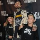 Travis Barker (top,center) and guests attend Knott's Scary Farm on October 1, 2015 in Buena Park, California - 399 x 600