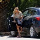 Doutzen Kroes in a cropped top and denim shorts in Ibiza - 454 x 334
