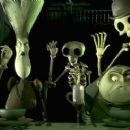Maudeline Everglot, voiced by JOANNA LUMLEY, and Finis Everglot, voiced by ALBERT FINNEY, are surrounded by residents of the Land of the Dead in Warner Bros. Pictures' animated fantasy 'Tim Burton's Corpse Bride,' photo courtesy of Warner - 454 x 245