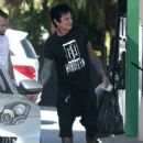 Rocker Tommy Lee stops for gas at a gas station in Calabasas, California on July 12, 2016 - 445 x 600