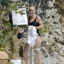 Caroline Wozniacki – In black swimsuit poolside in Portofino - 454 x 589