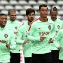 Cristiano Ronaldo takes part in training with Portugal team-mates after penalty miss as manager claims Real Madrid star is 'reserving his goals for the Euros'