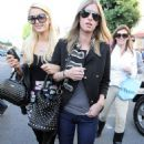 Paris Hilton teamed up with sister Nicky for a romp along the paparazzi-filled Robertson Blvd in Los Angeles on Friday (November 6).