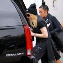 Madonna dresses all in black as she leaves the gym