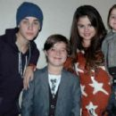 Justin Bieber posed with young fans and his girlfriend Selena Gomez