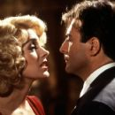 Sean Young and Armand Assante