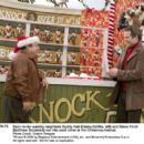 Soon-to-be-warring neighbors Buddy Hall (Danny DeVito, left) and Steve Finch (Matthew Broderick) run into each other at the Christmas festival. Photo credit: Doane Gregory - 454 x 402