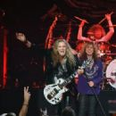 "Guitarist Joel Hoekstra, singer David Coverdale and drummer Tommy Aldridge of Whitesnake perform at The Joint inside the Hard Rock Hotel & Casino as the band tours in support of ""The Purple Album"" on June 4, 2015 in Las Vegas, Nevada."