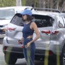 Nina Dobrev Takes her dog Maverick out for a walk in LA