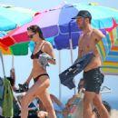 Dakota Johnson in Bikini on the beach in the Hamptons