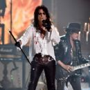 Singer Alice Cooper and musician Joe Perry of Hollywood Vampires perform onstage during The 58th GRAMMY Awards at Staples Center on February 15, 2016 in Los Angeles, California.