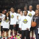 Nick Cannon, Ne-Yo, Rocsi Diaz, Trey Songz, Josh Hutcherson, Usain Bolt and Queen Latifah of Team East attend the 2013 NBA All-Star Celebrity Game at George R. Brown Convention Center on February 15, 2013 in Houston, Texas
