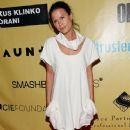 """Actress Rhona Mitra attends Markus Klinko & Indrani's """"Icons"""" presented by the Month of Photography Los Angeles at the Pacific Design Center on April 21, 2009 in West Hollywood, California."""