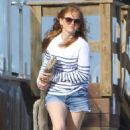 Isla Fisher in Jeans Shorts at the beach in Malibu