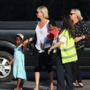 Charlize Theron- at a Cretan airport with her kids August 2016 - 454 x 475