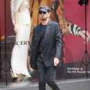 Ringo Starr wears a newsboy cap, blazer, and dark jeans as he runs errands in South Kensington
