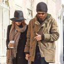Emma Stone and Andrew Garfield hold hands as they walk home after eating breakfast at Cafe Cluny on December 29, 2014 in New York City, New York