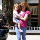 After a adventure-filled morning, Isla Fisher took her adorable daughters Olive and Elula out in Studio City, CA on Tuesday (August 14)